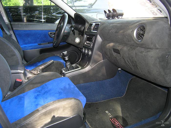 Перетяжка дверей Субару в автостудии New-Leather