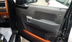Перетяжка дверных подлокотников в автостудии New-Leather